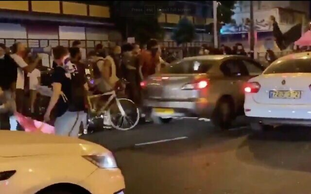 Screen capture from video of a car, center, as it hits anti-government protesters during a rally in Tel Aviv, October 1, 2020. (Twitter)