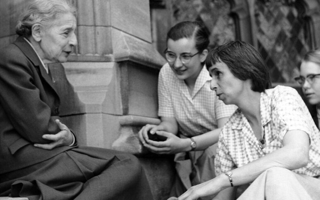 Chemist Lise Meitner with students (Sue Jones Swisher, Rosalie Hoyt and Danna Pearson McDonough) on the steps of the chemistry building at Bryn Mawr College. Courtesy of Bryn Mawr College. April 1959. (Public Domain via WikimediaCommons)