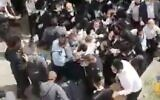 Screen capture from video of clashes between police and the ultra-Orthodox community in the settlement of Beitar Illit, October 4, 2020. (Twitter)