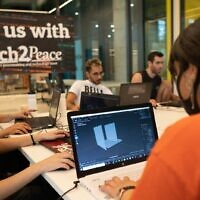 Participants get creative on their laptops during a seminar at Tech2Peace, September 2020 (Micha Silverman)