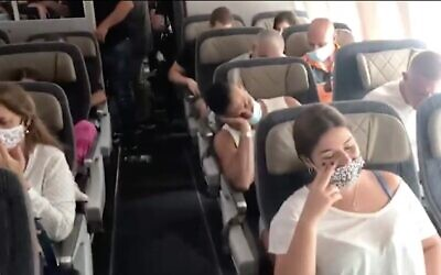Screen capture from video of passengers on an El Al flight to Athens that failed to take off due to engine trouble, October 1, 2020. (Ynet news)