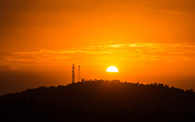 Illustrative: View of the sun setting over the mountains from Neve Ilan, outside Jerusalem. (Hadas Parush/Flash90)
