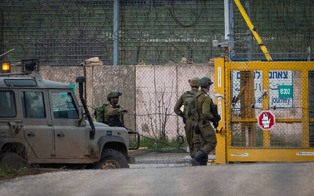 Illustrative: Israeli soldiers guard at the Israeli side of the Quneitra Crossing, on the Israeli-Syrian border, in the Golan Heights on March 23, 2019. (Basel Awidat/Flash90)