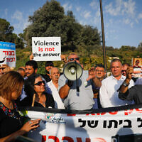 Members of the Arab Israeli community protest against violence, organised crime and recent killings among their communities, outside the Prime Minister's office in Jerusalem on October 10, 2019. (Yonatan Sindel/Flash90)
