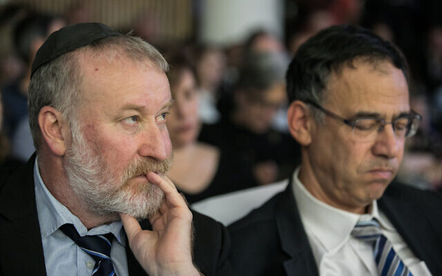 Attorney General Avichai Mandelblit, left, and outgoing state prosecutor Shai Nitzan attend a farewell ceremony held for Nitzan in Jerusalem, on December 18, 2019. (Olivier Fitoussi/Flash90)