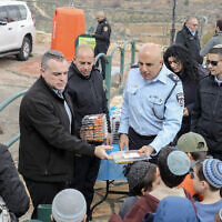 Illustrative:  Moshe Barkat (C), Police commander of the Judea and Samaria District attends a ceremony for the Jewish holiday of Tu Bishvat in the West Bank settlement of Efra on February 11, 2020. (Gershon Elinson/Flash90)