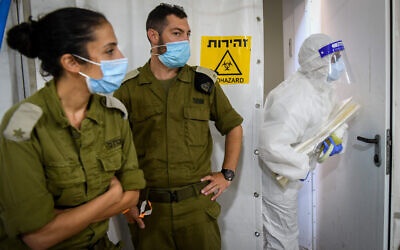 Illustrative. Israeli army technicians carry out a diagnostic test for coronavirus in a military lab in central Israel on July 15, 2020. (Yossi Zeliger/Flash90)