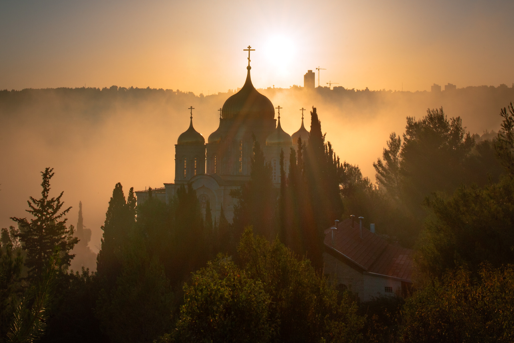 The sun rises over the Moscovia Monastery, in Ein Kerem, Jerusalem on July 31, 2020. (Mila Aviv/Flash90)