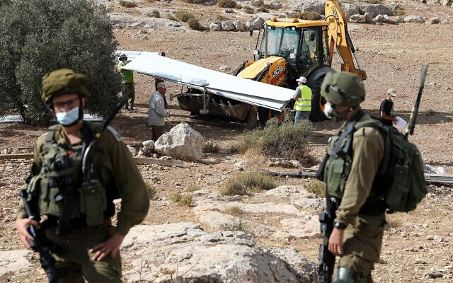 Israel demolishes a house built without a permit in Yatta, in the West Bank on August 11, 2020 (Wisam Hashlamoun/Flash90)