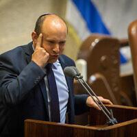 Yamina leader Naftali Bennett speaks during a Knesset plenary session at the Knesset, August 24, 2020. (Oren Ben Hakoon/ POOL)
