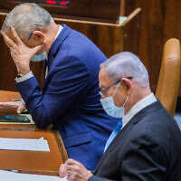 Alternate Prime Minister and Minister of Defense Benny Gantz, and Prime Minister Benjamin Netanyahu, seen during a vote at the Knesset on August 24, 2020. (Oren Ben Hakoon/POOL)
