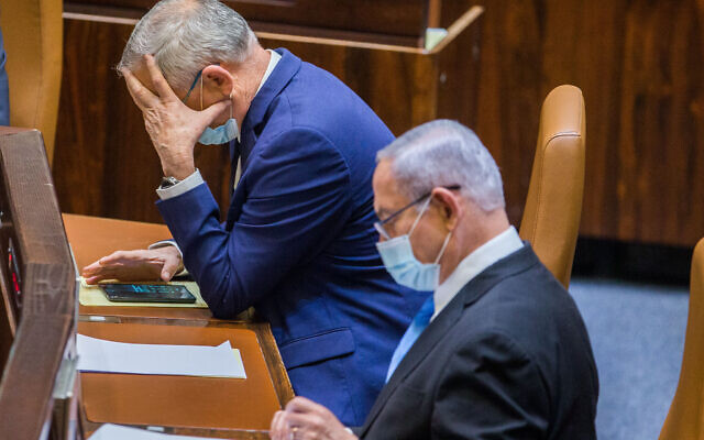 Alternate Prime Minister and Minister of Defense Benny Gantz and Israeli Prime Minister Benjamin Netanyahu seen during a vote at the Knesset, the Israeli parliament in Jerusalem on August 24, 2020. (Oren Ben Hakoon/POOL)