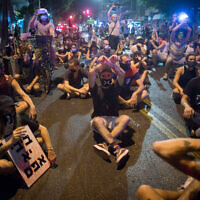 Protesters block a road as they protest against Prime Minister Benjamin Netanyahu in Tel Aviv on September 30, 2020. (Miriam Alster/Flash90)