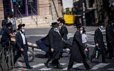 People walk in the ultra-Orthodox neighborhood of Mea Shearim, Jerusalem, October 1, 2020 (Yonatan Sindel/Flash90)