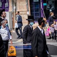 Illustrative: Ultra-Orthodox Jews in the Jerusalem neighborhood of Mea Shearim on October 2, 2020. (Yonatan Sindel/Flash90)