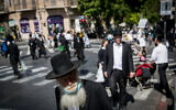 Ultra-Orthodox Jews in the Jerusalem neighborhood of Mea Shearim on October 2, 2020. (Yonatan Sindel/Flash90)