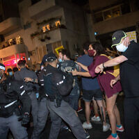 Israelis protest against Prime Minister Benjamin Netanyahu at Habima Square in Tel Aviv on October 3, 2020 (Miriam Alster/Flash90)