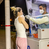 Israelis perform tests for the coronavirus at a Maccabi Test Center, in Ramle. October 5, 2020. (Yossi Aloni/FLASH90)