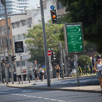 An empty road in Tel Aviv on October 8, 2020, during a nationwide coronavirus lockdown. (Miriam Alster/Flash90)