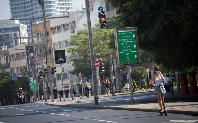 An empty road in Tel Aviv on October 8, 2020, during a nationwide coronavirus lockdown. (Miriam Alster/Flash90)