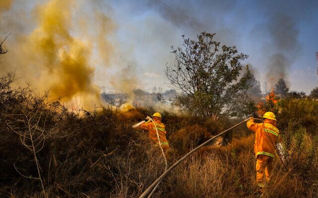 Firemen fight flames near the Kfar HaOranim settlemet in the West Bank, October 9, 2020 (Yossi Aloni/Flash90)