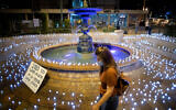 """Candles placed by activists from the """"Darkeinu"""" movement in memory of Israel's coronavirus victims, near the prime minister's official residence in Jerusalem on October 12, 2020. (Yonatan Sindel/Flash90)"""