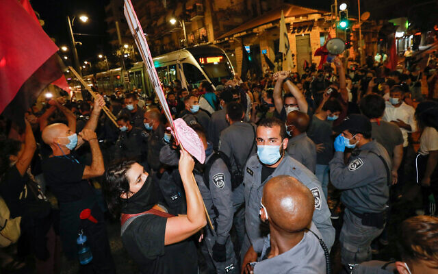 Illustrative: Police scuffle with anti-Netanyahu protesters block the light rail tracks on Jaffa Street in downtown Jerusalem, October 17, 2020. ( Olivier Fitoussi/Flash90)