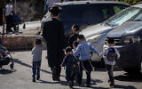 Ultra-Orthodox kids make their way back home from a Talmud Torah in Jerusalem, October 18, 2020. (Yonatan Sindel/Flash90)