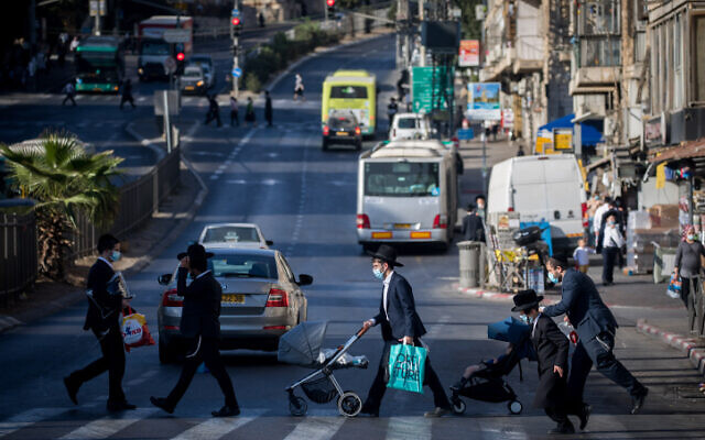 Illustrative: Ultra-Orthodox Jews walk in Jerusalem on October 19, 2020. (Yonatan Sindel/Flash90)