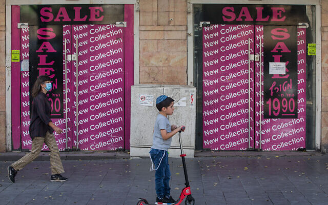 A child plays in the city center of Jerusalem as Israel steps out of coronavirus lockdown and rolls back restrictions on October 21, 2020. (Nati Shohat/Flash90)
