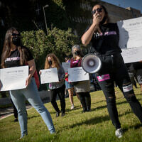 Activists protest against recent cases of violence against women outside the Knesset in Jerusalem, October 21, 2020. (Yonatan Sindel/Flash90)