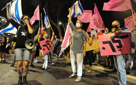Anti-government protesters march against Prime Minister Benjamin Netanyahu in the city of Haifa on October 22, 2020. (Meir Vaknin/Flash90)