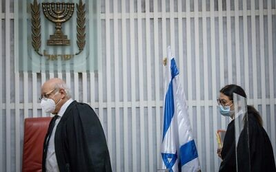 Chief Justice Esther Hayut (R) and High Court Justice Hanan Melcer arrive to a hearing on petitions against the position of alternate prime minister, at the Supreme Court in Jerusalem, October 27, 2020. (Yonatan Sindel/Flash90)
