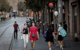 People walk on Jaffa Street in downtown Jerusalem on October 28, 2020. (Nati Shohat/Flash90)