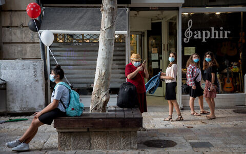 People walk in downtown Jerusalem on October 28, 2020. (Nati Shohat/Flash90)
