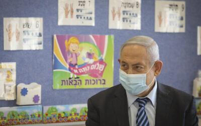 Prime Minister Benjamin Netanyahu visits Israeli kids on the first day of the school year in Mevo Horon on September 1, 2020. (Marc Israel Sellem/Pool)
