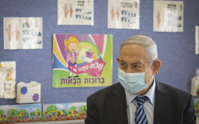 Prime Minister Benjamin Netanyahu visits Israeli kids on the first day of the school year in Mevo Horon on September 1, 2020. (Marc Israel Sellem/Pool)