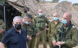 Prime Minister Benjamin Netanyahu (L) visits a military drill in northern Israel on October 28, 2020. (Amos Ben Gershom/GPO)