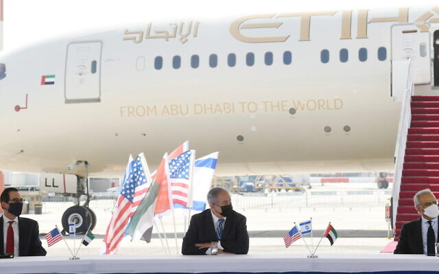 From L to R: US Secretary Mnuchin, PM Netanyahu and UAE UAE Minister of State for Financial Affairs Obaid Humaid Al Tayer at a ceremony during which Israel and the UAE signed four bilateral agreements at Tel Aviv's Ben-Gurion Airport, October 20, 2020 (Amos Ben Gershom/GPO)