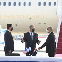 US Treasury Secretary Steven Mnuchin (L), Prime Minister Benjamin Netqanyahu (C) and UAE Minister of State for Financial Affairs Obaid Humaid Al Tayer (R) at Ben Gurion Airport, October 20, 2020 (Amos Ben Gershom/GPO)