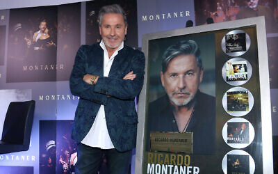 Ricardo Montaner poses for photos with his recognition for record sales during a press conference in Mexico City, July 4, 2019. (Adrián Monroy/Medios y Media/Getty Images via JTA)