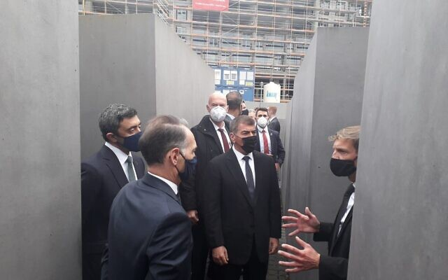 Israeli Foreign Minister Gabi Ashkenazi, second right, UAE Foreign Minister Abdulah Bin Zayed al Nahyan, left, and German Foreign Minister Heiko Maas, second left, listening to a presentation at the Berlin Holocaust Memorial on October 6, 2020. (Courtesy/Foreign Ministry of Israel)