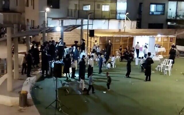 Screen capture from video filmed at the start of an alleged mass Sukkot celebration in the Kiryat Belz neighborhood of Jerusalem, October 7, 2020; the reporter who filmed it filed a police complaint, saying he was assaulted by participants. (Twitter)
