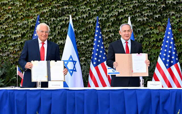 USAmbassador to Israel David M. Friedman and Prime Minister Benjamin Netanyahu sign agreements to further binational scientific and technological cooperation in a special ceremony held at Ariel University on October 28, 2020 (Matty Stern/US Embassy Jerusalem)