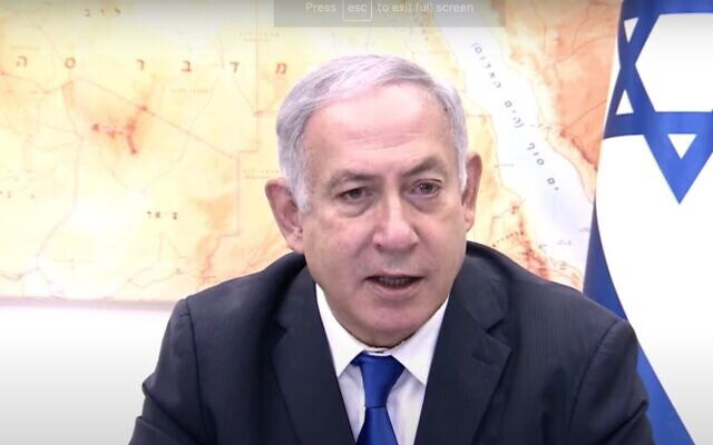 Screen capture from video of Prime Minister Benjamin Netanyahu at the start of the weekly cabinet meeting, October 18, 2020. (YouTube)