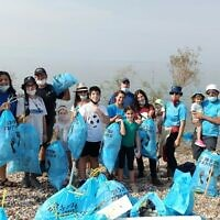Volunteers in Israel's beach cleanup efforts, October 30, 2020 (Society for the Protection of Nature in Israel)