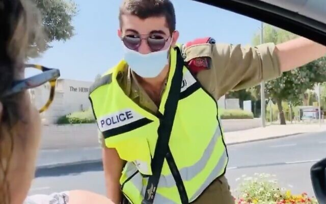 A protester argues with a soldier at a roadblock outside the Knesset in Jerusalem on September 29, 2020. (Screen capture: Twitter)