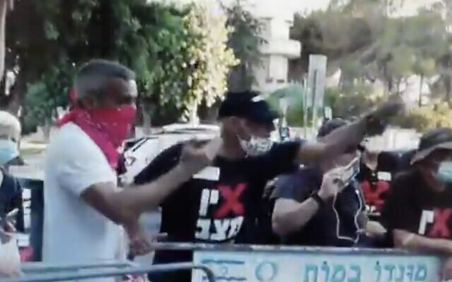 Footage aired by Channel 12 news on October 7, 2020, shows retired air force general Amir Haskel during a protest in August outside the Prime Minister's Residence in Jerusalem. (Screen capture: Twitter)