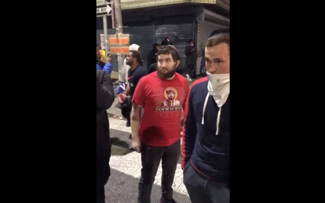 A screen shot from a video of an incident in Philadelphia in which visibly Jewish men at a Black Lives Matter protest were shoved and told to leave, October 27, 2020. (Screenshot from Instagram via JTA)