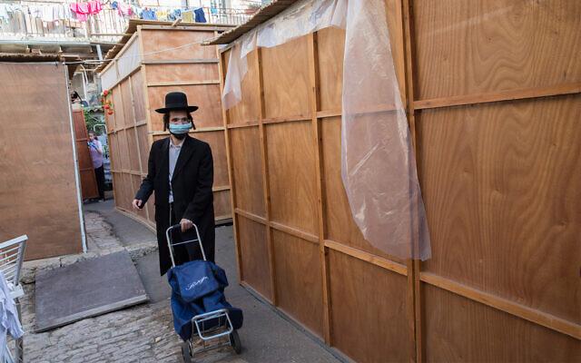 Newly built sukkahs in the Jerusalem neighborhood of Nachlaot, October 1, 2020. (Nati Shohat/Flash90)